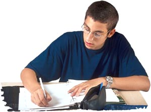Fish oil benefits: Boosting brain power and concentration. Man writing or doing school work.
