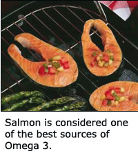 Salmon is one of the best fish to eat if you want those healthy Omega 3 fatty acids. Picture of salmon steaks on the grill.