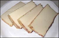 Slices of tofu on a plate.